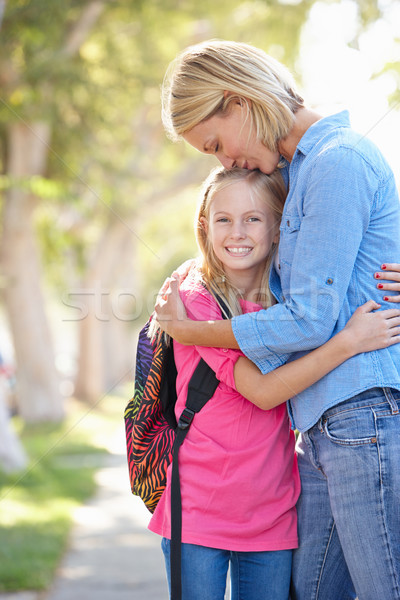 Mother And Daughter Walking To School On Suburban Street Stock photo © monkey_business