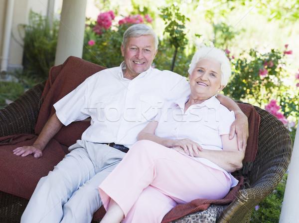Couple de personnes âgées détente jardin siège regarder Photo stock © monkey_business