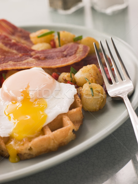 Waffles with Bacon Fried Potatoes and a Broken fried Egg Stock photo © monkey_business