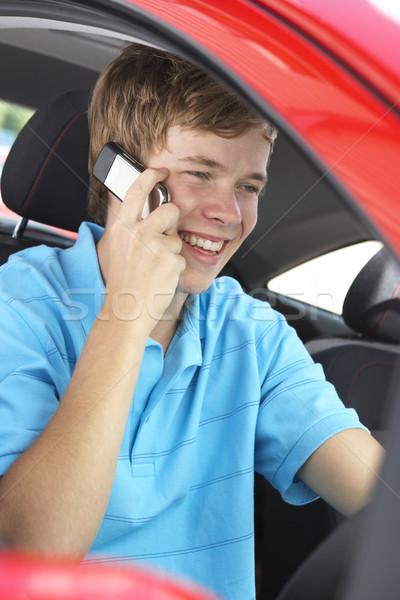 Teenage Boy Sitting In Car, Talking On Cellphone Stock photo © monkey_business