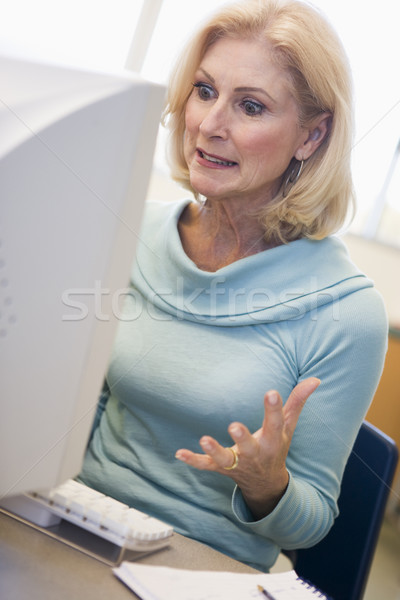 Mature female student expressing frustration at computer Stock photo © monkey_business