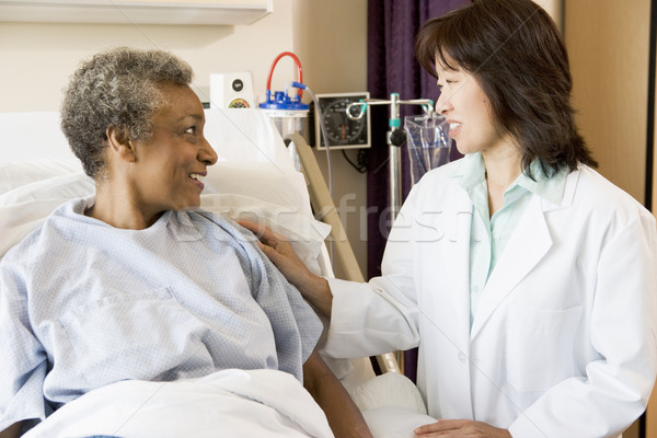 Stock photo: Doctor Talking To Senior Woman