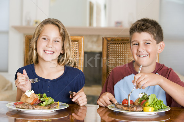 Brother And Sister Eating meal, mealtime Together  Stock photo © monkey_business