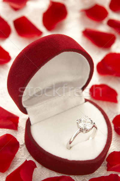 Diamond Ring In Heart Shaped Box Surrounded By Rose Petals Stock photo © monkey_business