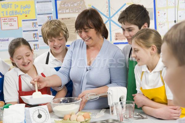 Schoolchildren and teacher at school in a cooking class Stock photo © monkey_business