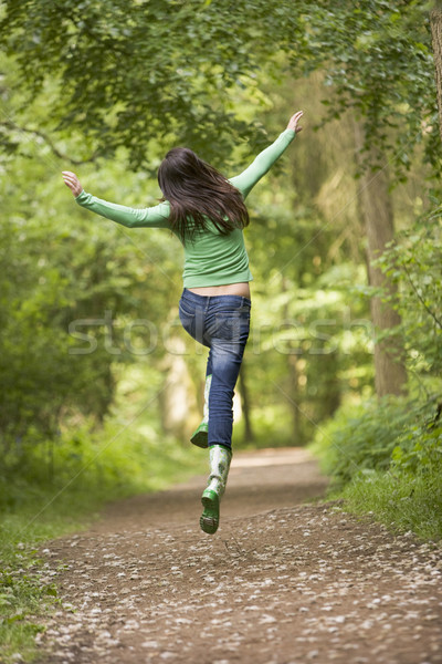 Stock photo: Woman jumping on path