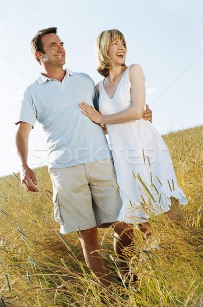 Casal em pé ao ar livre sorridente mulher homem Foto stock © monkey_business