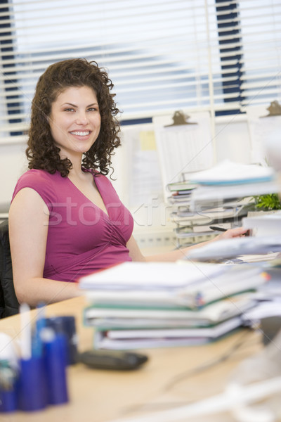 Donna seduta felicemente desk business felice Foto d'archivio © monkey_business