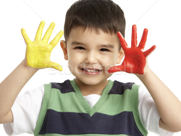 Studio Portrait Of Young Boy With Painted Hands Stock photo © monkey_business