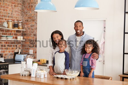 Mixed race family with Christmas tree and gifts Stock photo © monkey_business