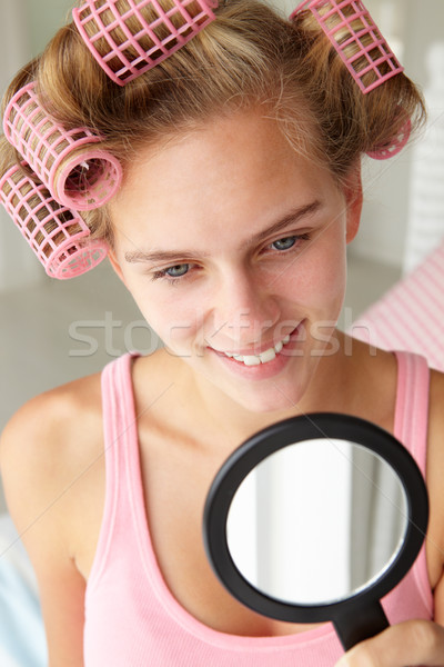 Teenage girl with hair in curlers Stock photo © monkey_business