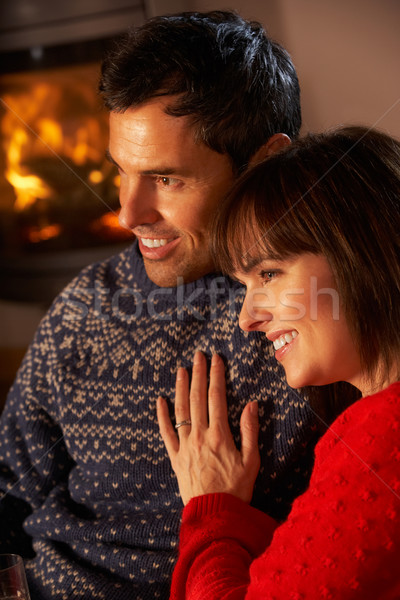 Middle Aged Couple Sitting Sofa Watching TV By Cosy Log Fire Stock photo © monkey_business