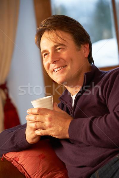 Relaks gorący napój sofa oglądania telewizja Zdjęcia stock © monkey_business