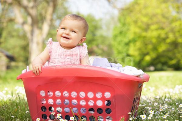 Estate abito seduta cestino di lavanderia baby Foto d'archivio © monkey_business