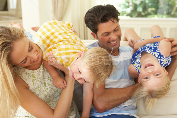 Family Playing On Sofa At Home Stock photo © monkey_business