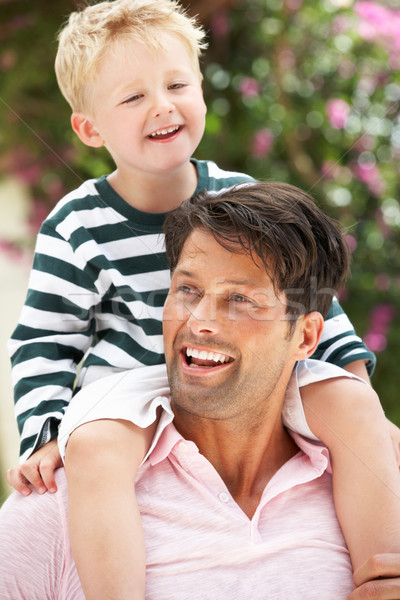 Father Giving Son Ride On Shoulders Outdoors Stock photo © monkey_business
