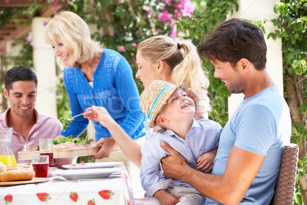 Idős nő adag többgenerációs család étel nők Stock fotó © monkey_business