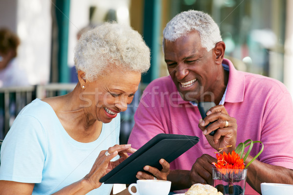 Senior Couple Using Tablet Computer At Outdoor Caf Stock photo © monkey_business