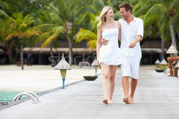 Stock photo: Couple Walking On Wooden Jetty