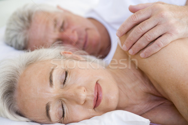 Couple lying in bed together sleeping Stock photo © monkey_business