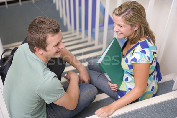 Male and female college students sitting on stairs Stock photo © monkey_business