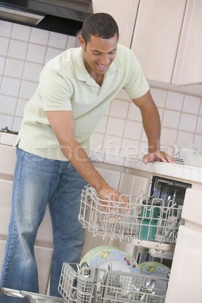 Man Loading Dishwasher  Stock photo © monkey_business