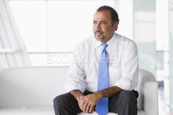 Imprenditore seduta divano ufficio uomo Foto d'archivio © monkey_business