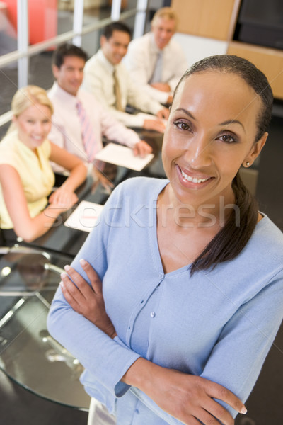 Businesswoman with four businesspeople at boardroom table in bac Stock photo © monkey_business
