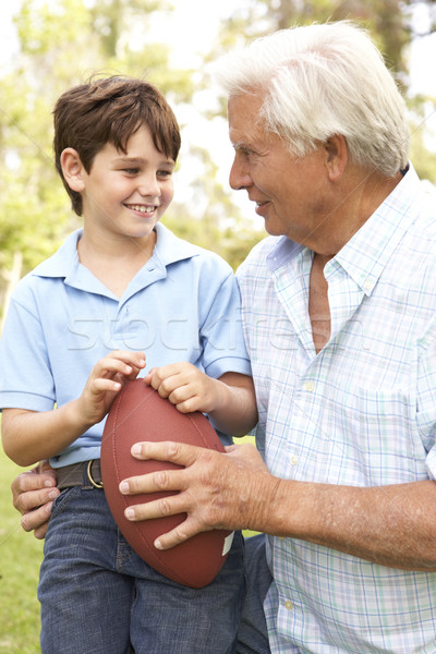 Grandfather And Grandson Playing American Football Together Stock photo © monkey_business