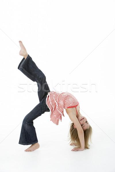 Young Girl Doing Backflip In Studio Stock photo © monkey_business