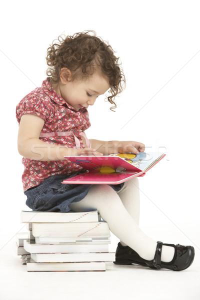 Joven sesión libros lectura cara Foto stock © monkey_business