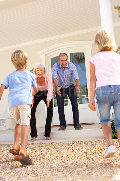 Grandparents Welcoming Grandchildren On Visit To Home Stock photo © monkey_business