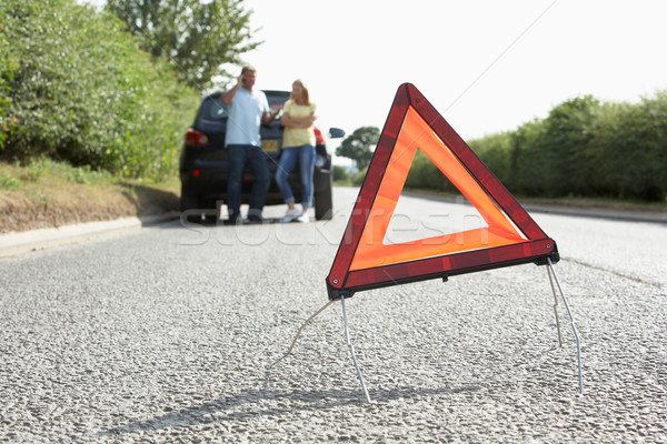 Couple Broken Down On Country Road With Hazard Warning Sign In F Stock photo © monkey_business