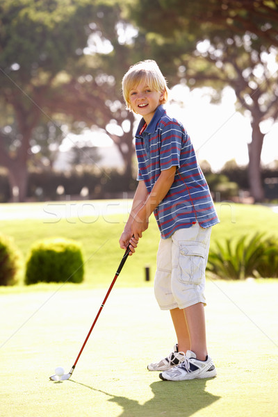 Young Boy Practising Golf On Putting On Green Stock photo © monkey_business