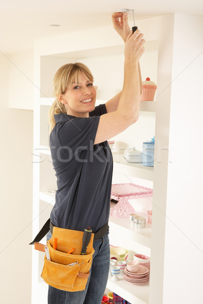 Female Electrician Installing Light Fitting In Home Stock photo © monkey_business