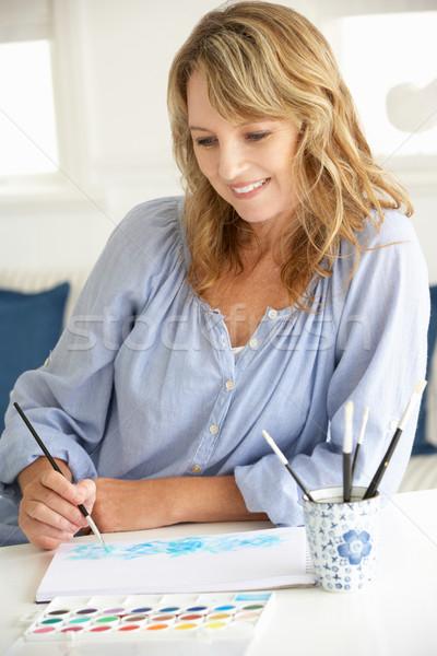 Vrouw schilderij tabel portret borstel Stockfoto © monkey_business