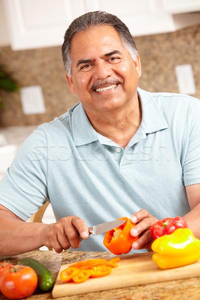Senior man chopping vegetables Stock photo © monkey_business