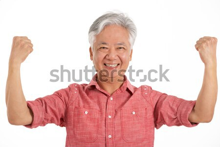 Studio Shot Of Jubilant Chinese Senior Man Stock photo © monkey_business