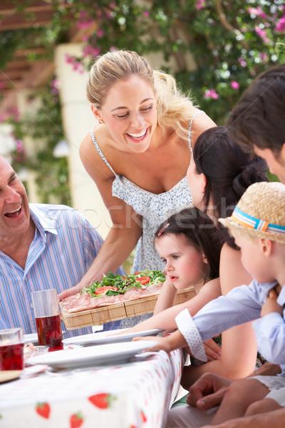 Nő adag többgenerációs család étel gyerekek férfi Stock fotó © monkey_business