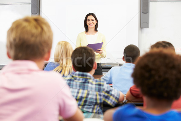 Professor em pé classe alunos mulher crianças Foto stock © monkey_business