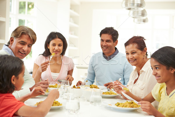 Multi Generation Indian Family Eating Meal At Home Stock photo © monkey_business