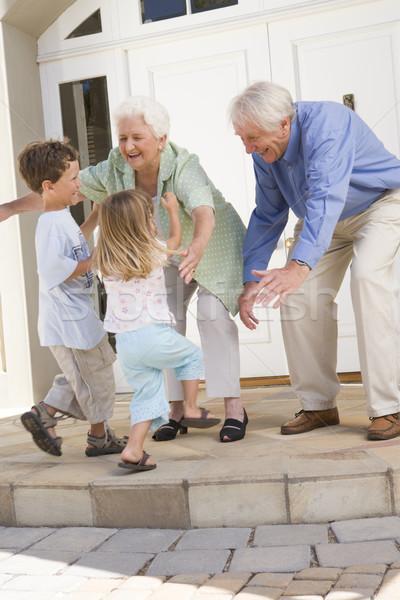 Grandparents welcoming grandchildren Stock photo © monkey_business