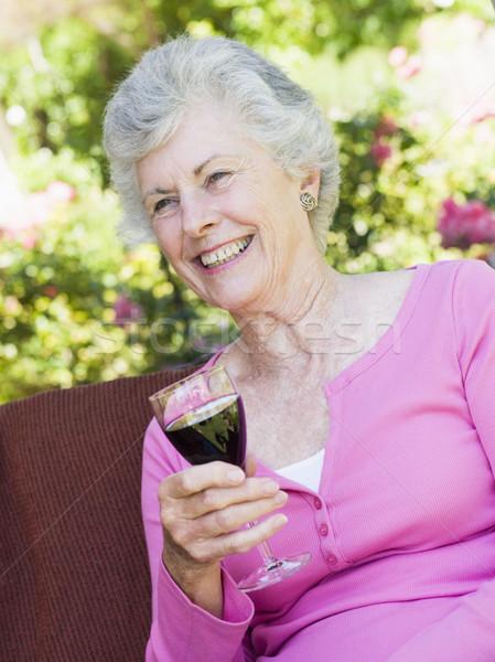 Stock photo: Senior woman enjoying glass of wine