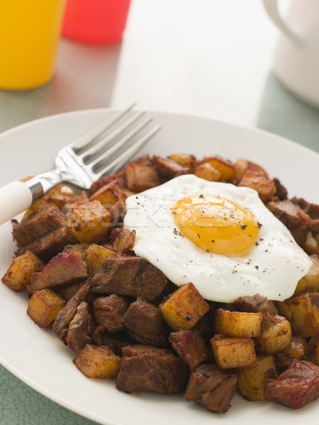Corned Beef Hash With a Fried Egg and Black Pepper Stock photo © monkey_business