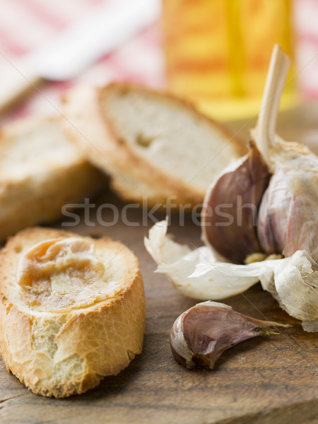 Cloves of Roasted Garlic spread on Toasted baguette Stock photo © monkey_business