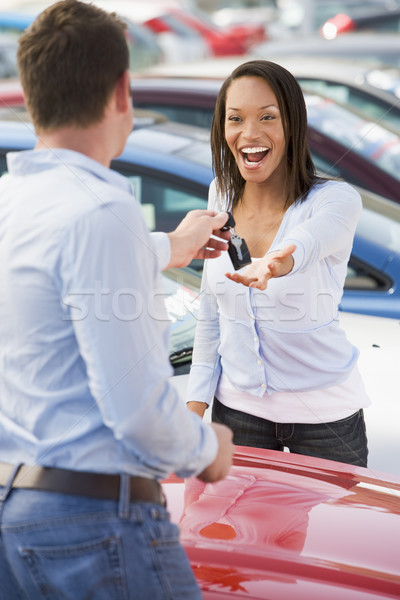 Woman collecting keys to new car Stock photo © monkey_business