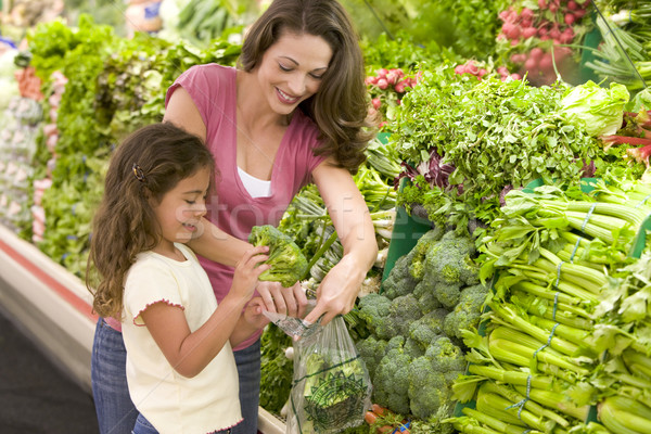 Mother and daughter shopping for produce Stock photo © monkey_business