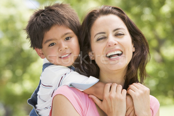 Woman and young boy outdoors embracing and smiling Stock photo © monkey_business