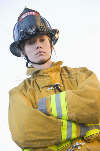 Stock photo: Portrait of a female firefighter