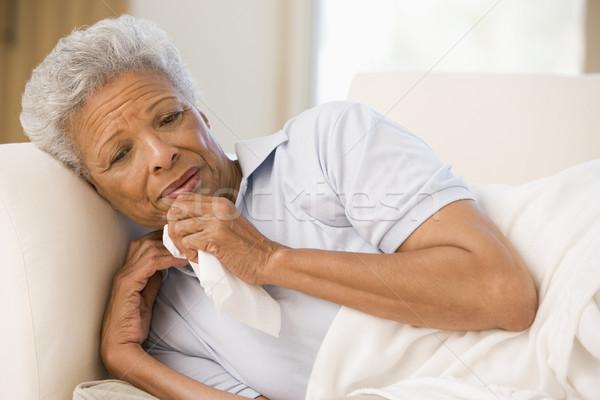 Mujer sonarse la nariz salud sofá enfermos altos Foto stock © monkey_business